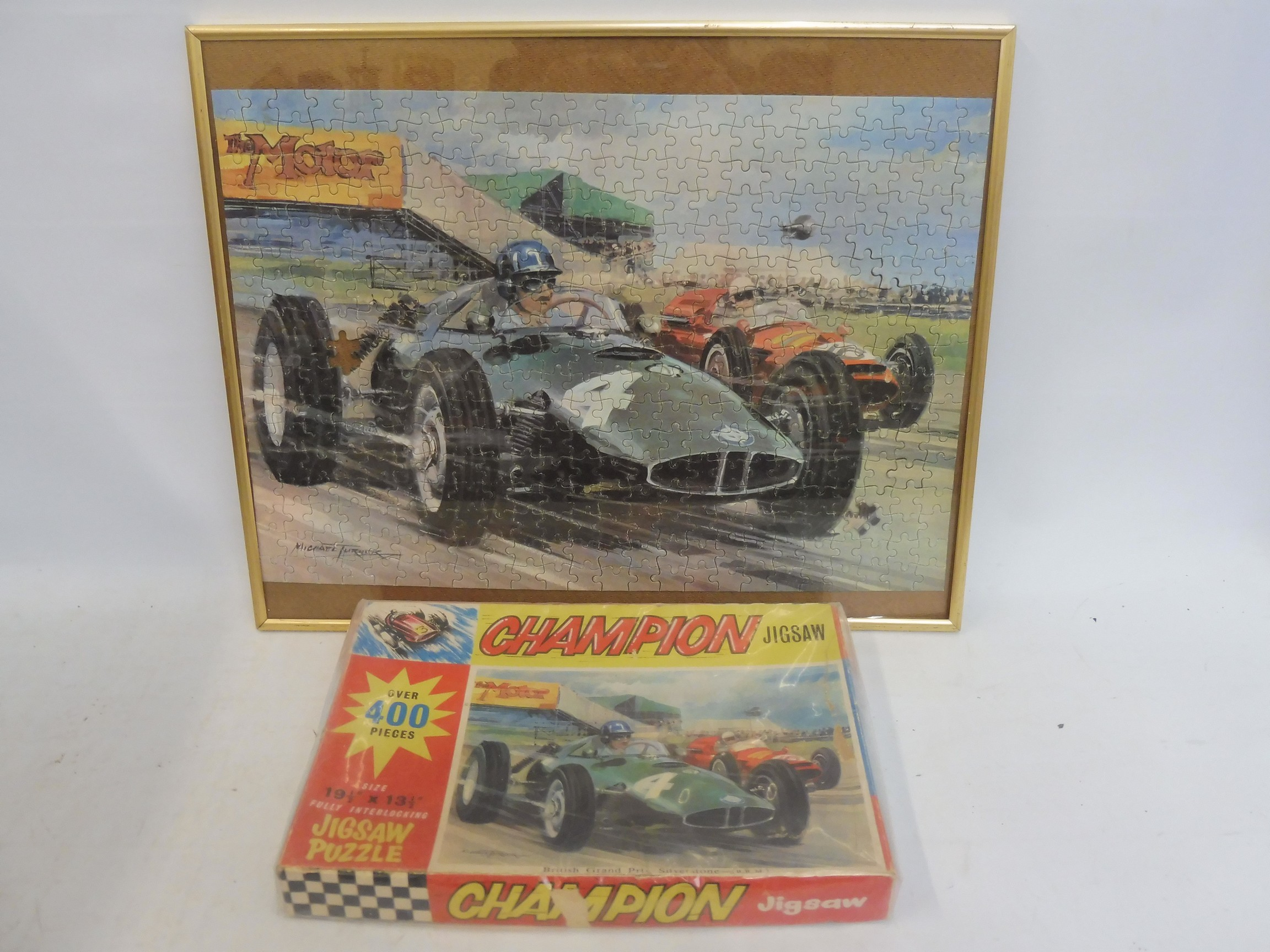 A framed and glazed Champion jigsaw puzzle, with accompanying original box, the scene depicting