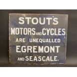 An unusual enamel sign advertising Stout's Motors and Cycles, Egremont and Seascale, by Richmonds