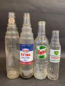 Three quart glass oil bottles for Castrol, Esso Extra and Essolube, plus a BP Energol pint bottle.
