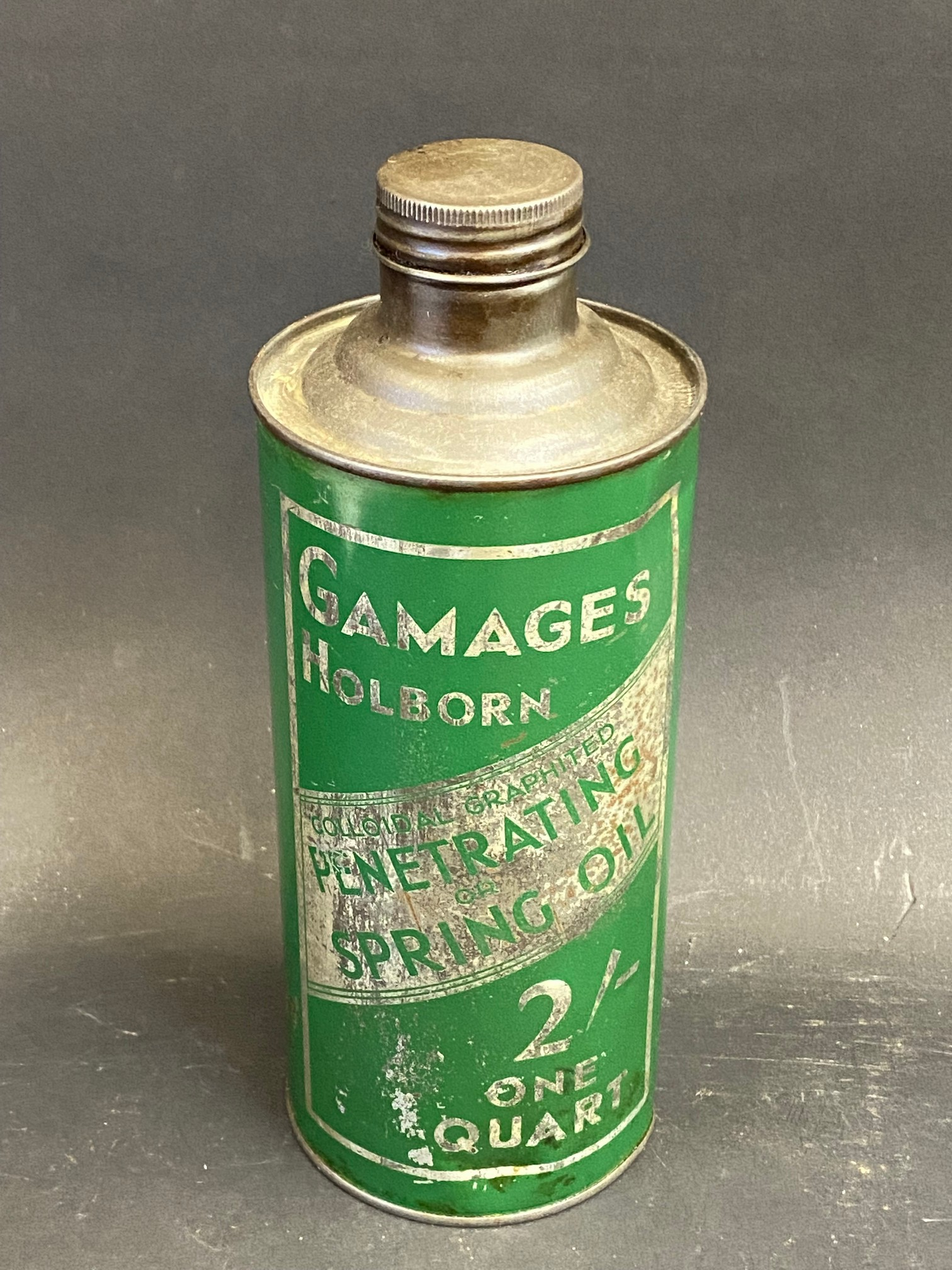 A Gamages Holborn Penetrating Spring Oil cylindrical quart can in good condition.