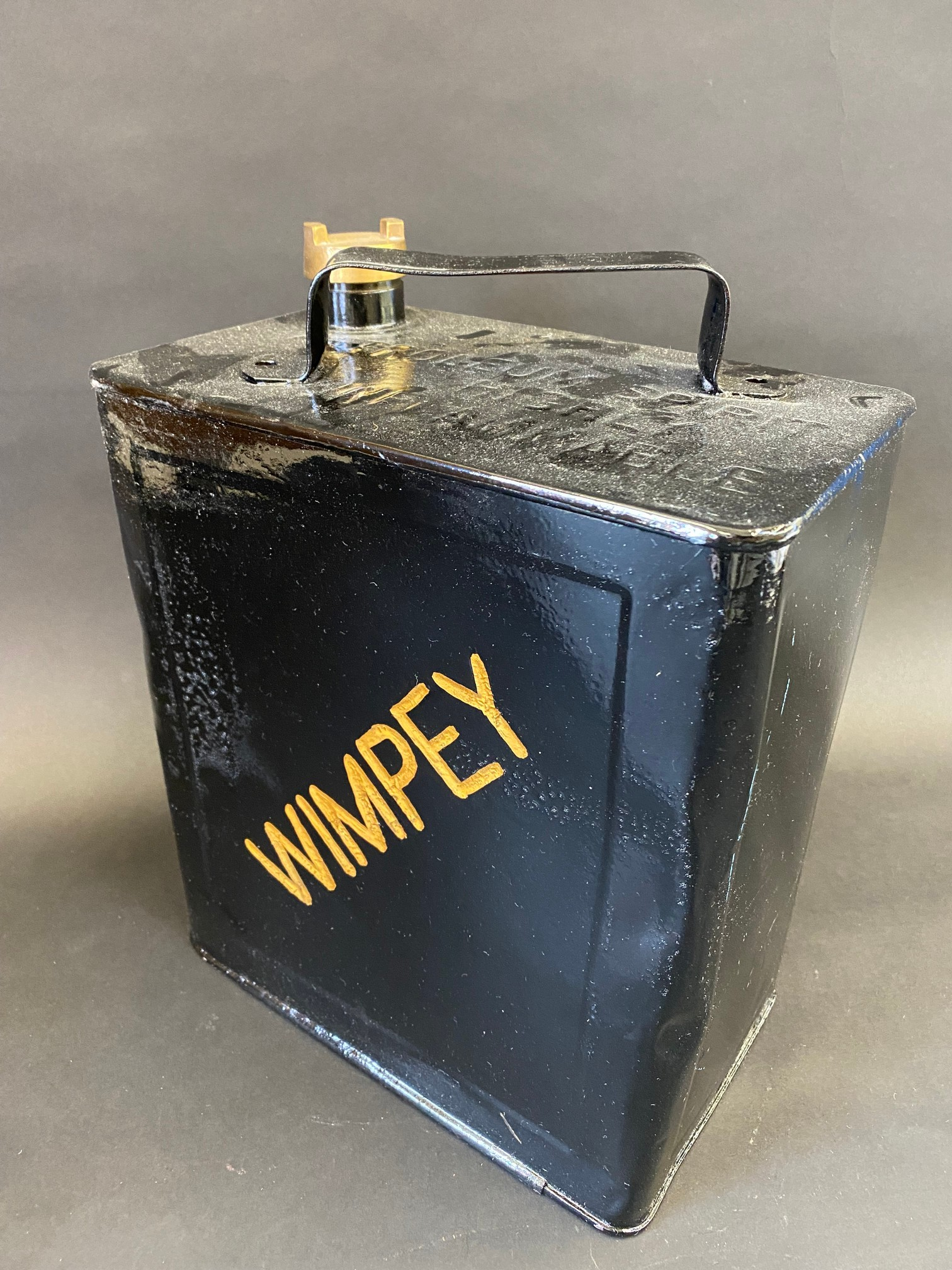 A Wimpey two gallon petrol can by Valor, dated IV, repainted, plain cap.