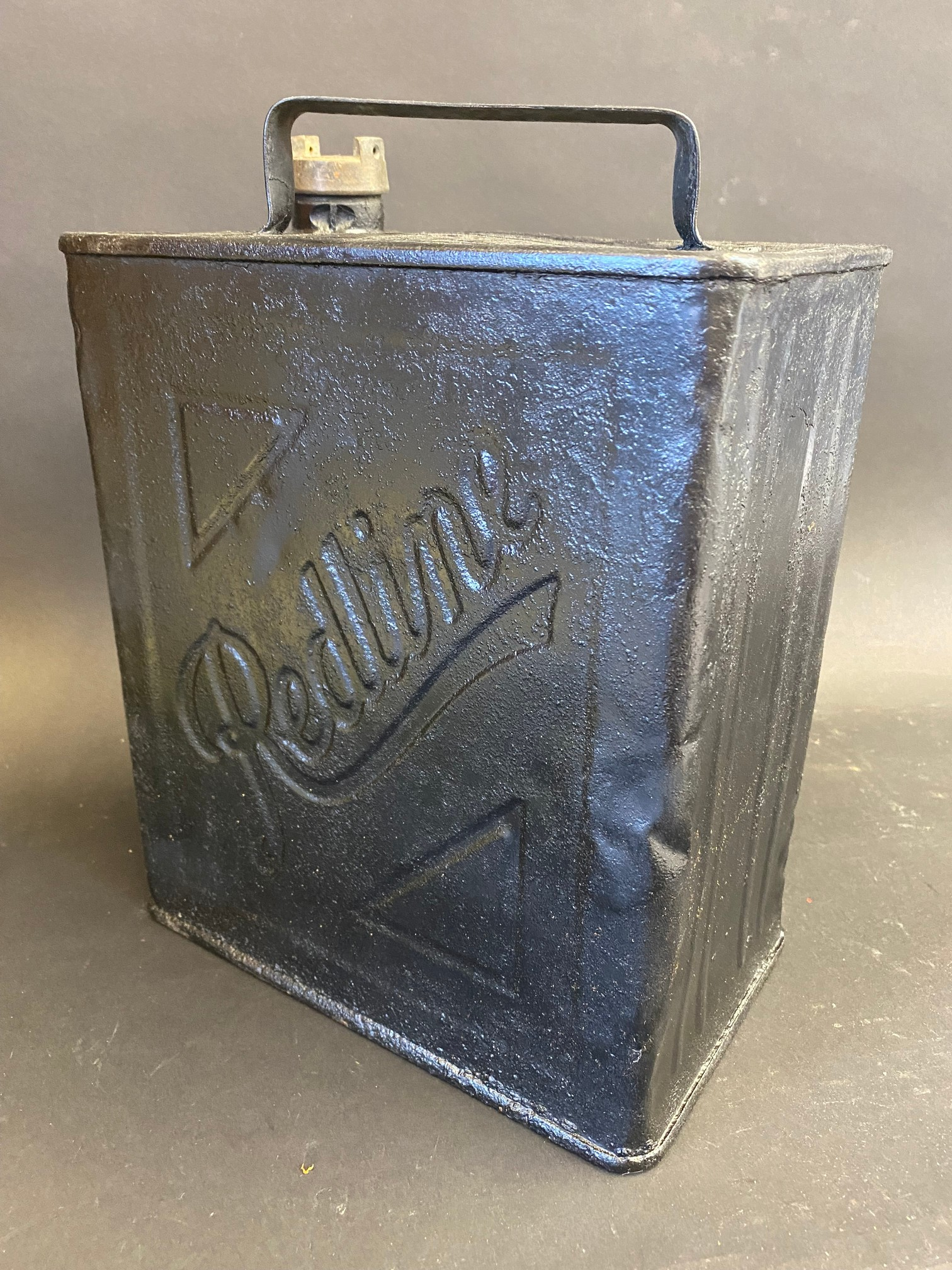 A Redline two gallon petrol can by Valor, indistinctly dated.
