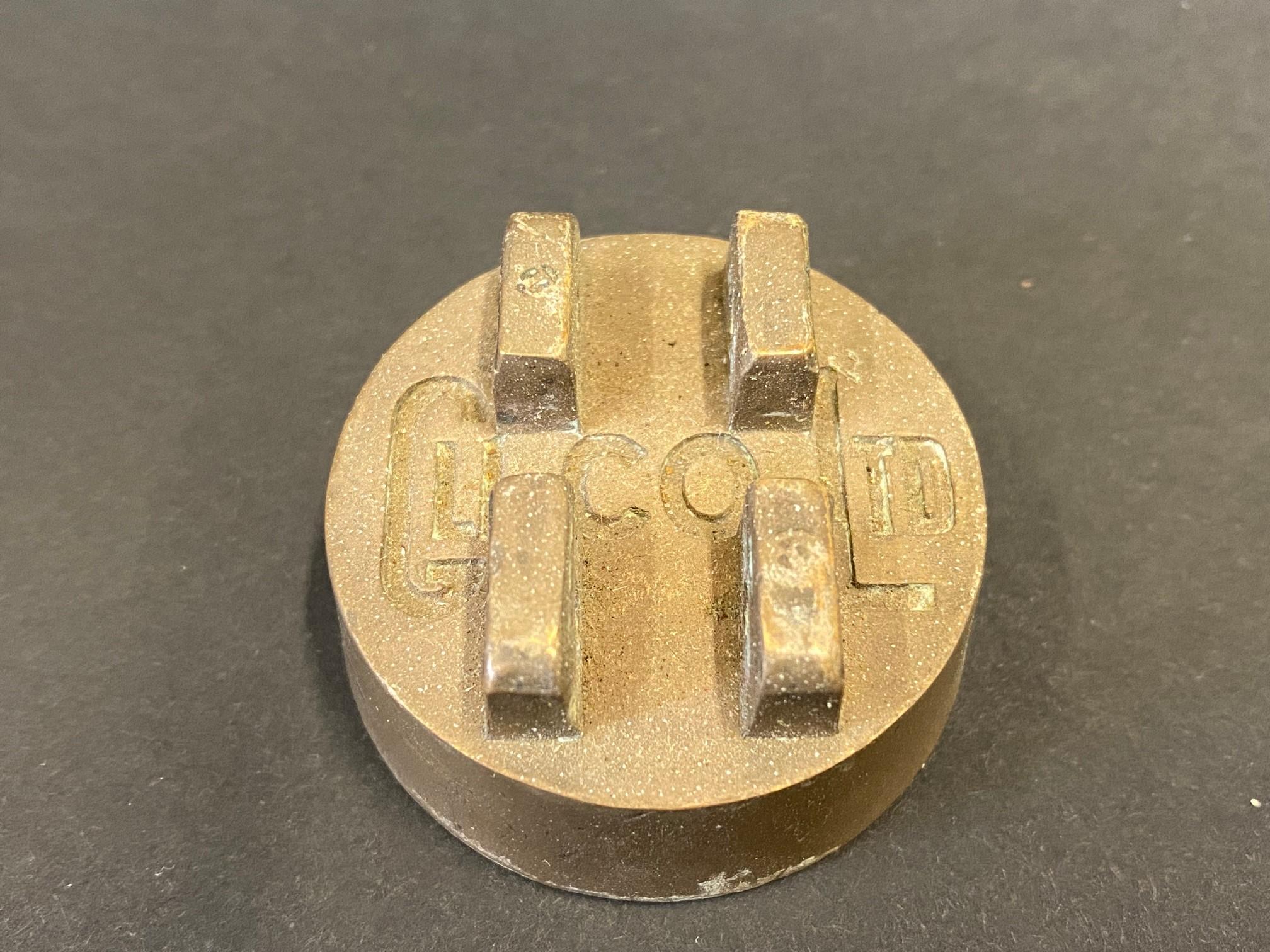 A Glico two gallon petrol can cap.