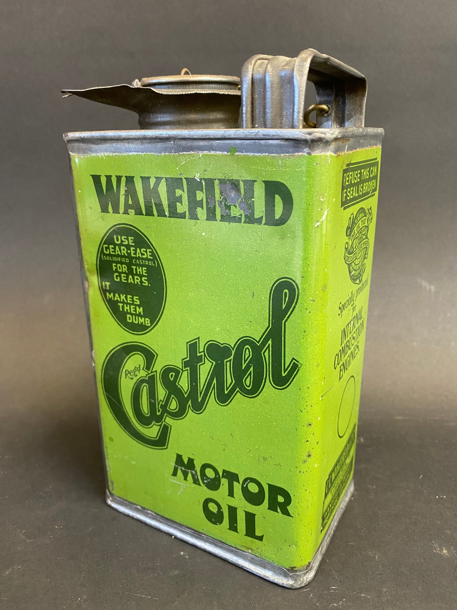 An early Wakefield Castrol Motor Oil quart oil can, early light green version in good condition,