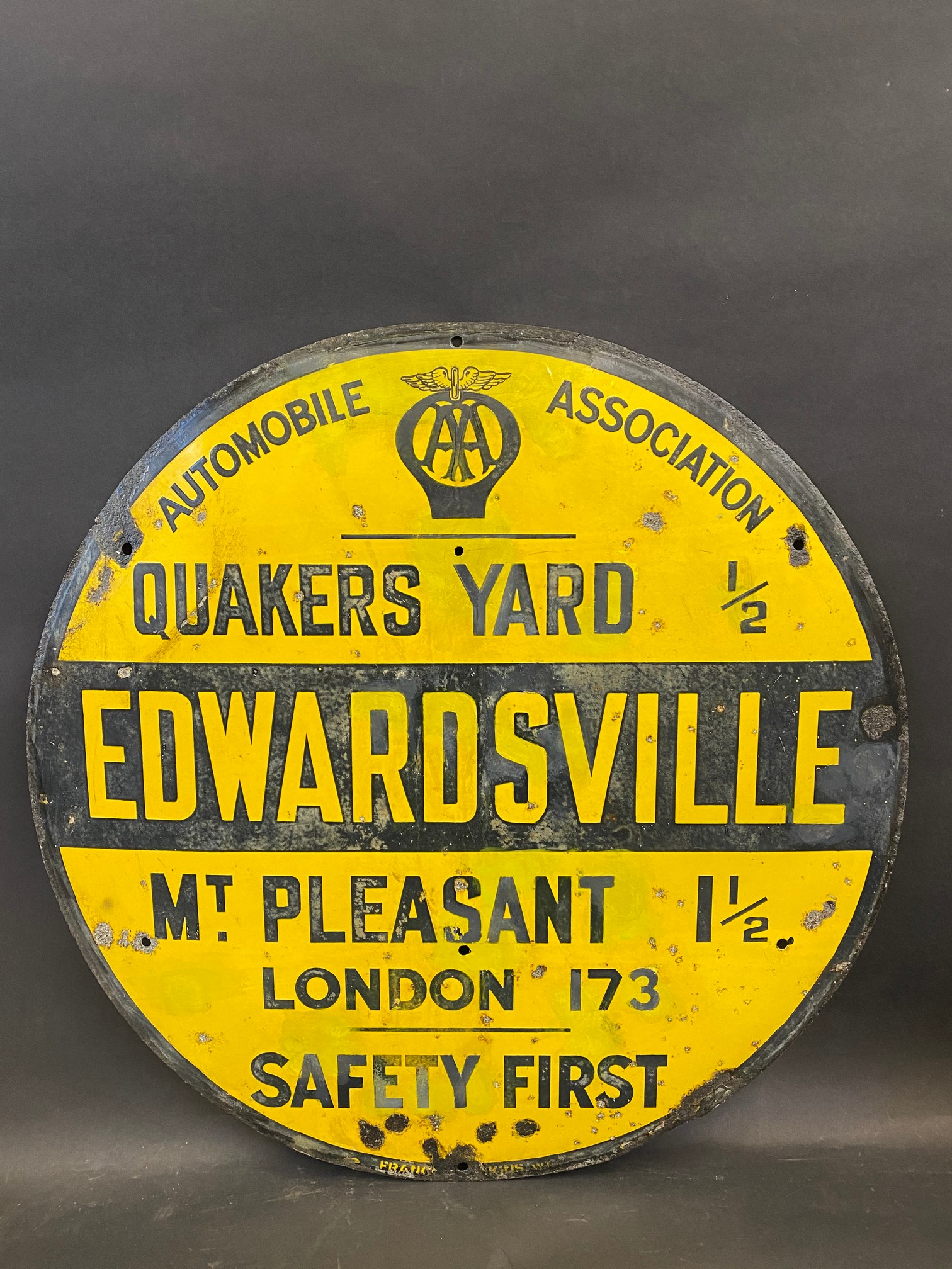 """A circular AA road/village sign for Edwardsville, by Franco, restored, 30"""" diameter."""