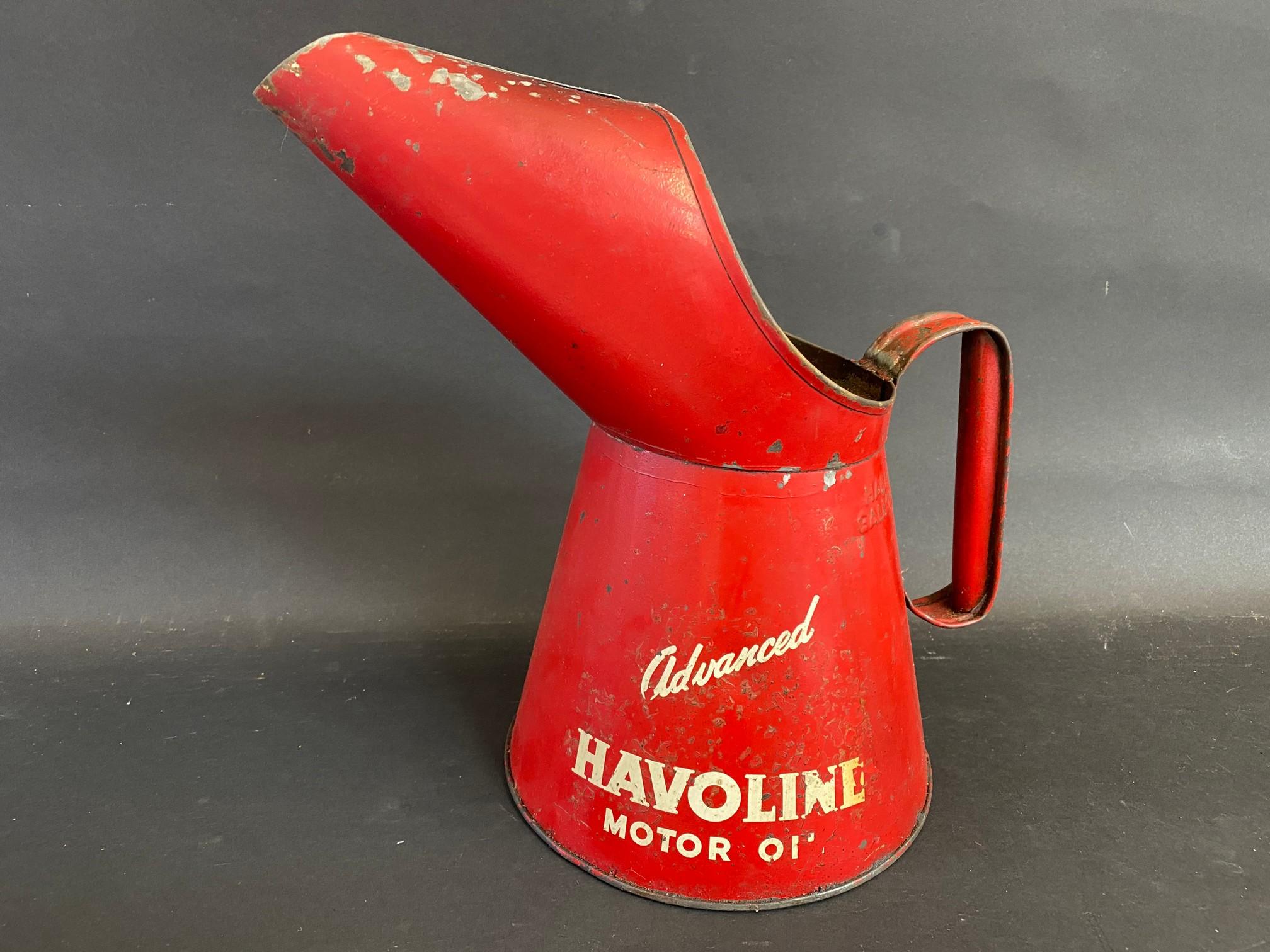 A Havoline Motor Oil half gallon measure.