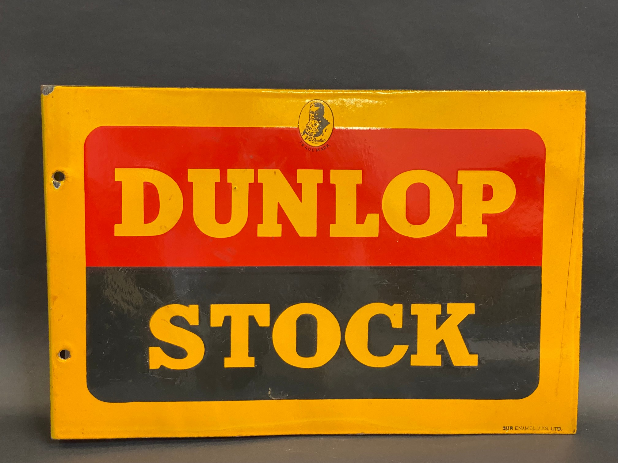 A Dunlop Stock double sided enamel sign with hanging flange, in near mint condition, made by Sur