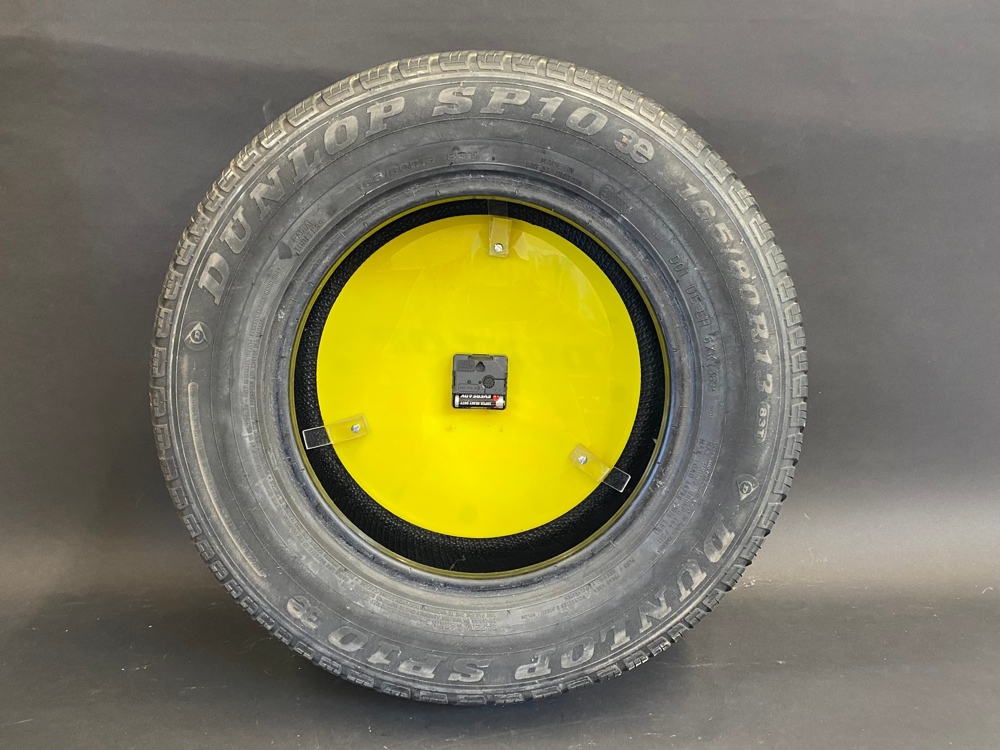 """A quirky Dunlop Radial Tyres perspex advertising clock set within a full size car tyre, 22 1/2"""" - Image 2 of 2"""