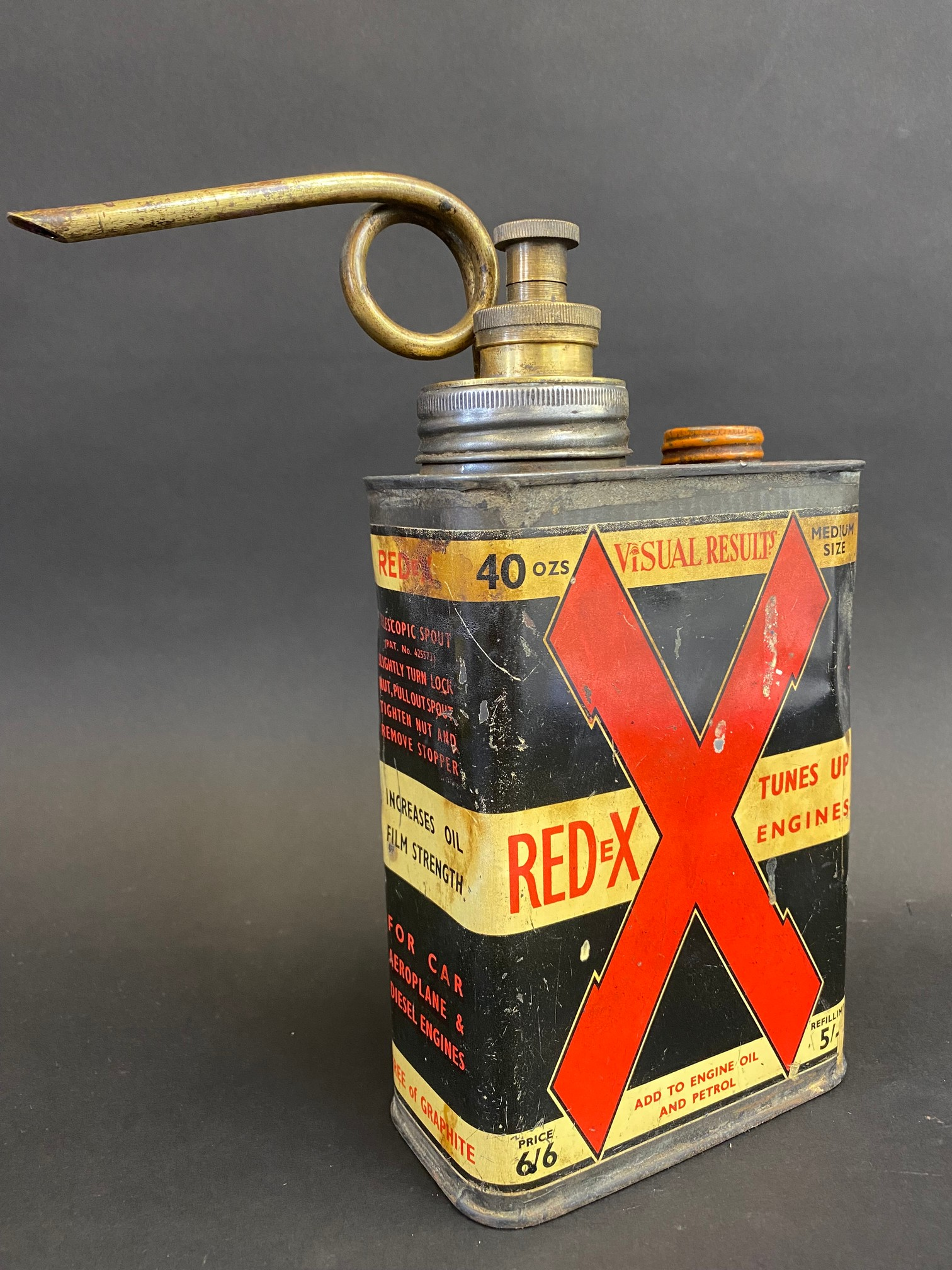 A Redex rectangular quart additive tin with brass plunger and spout.