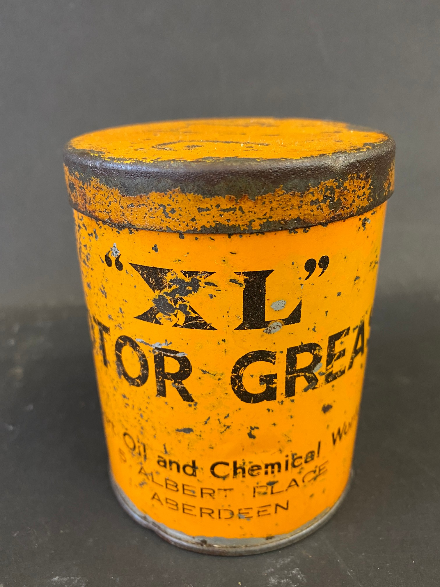 An XL Motor Grease tin.