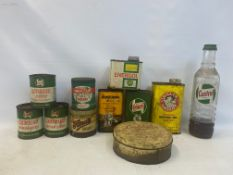 A Castrol Motor Oil quart glass bottle, three Castrol grease tins, two further grease tins and
