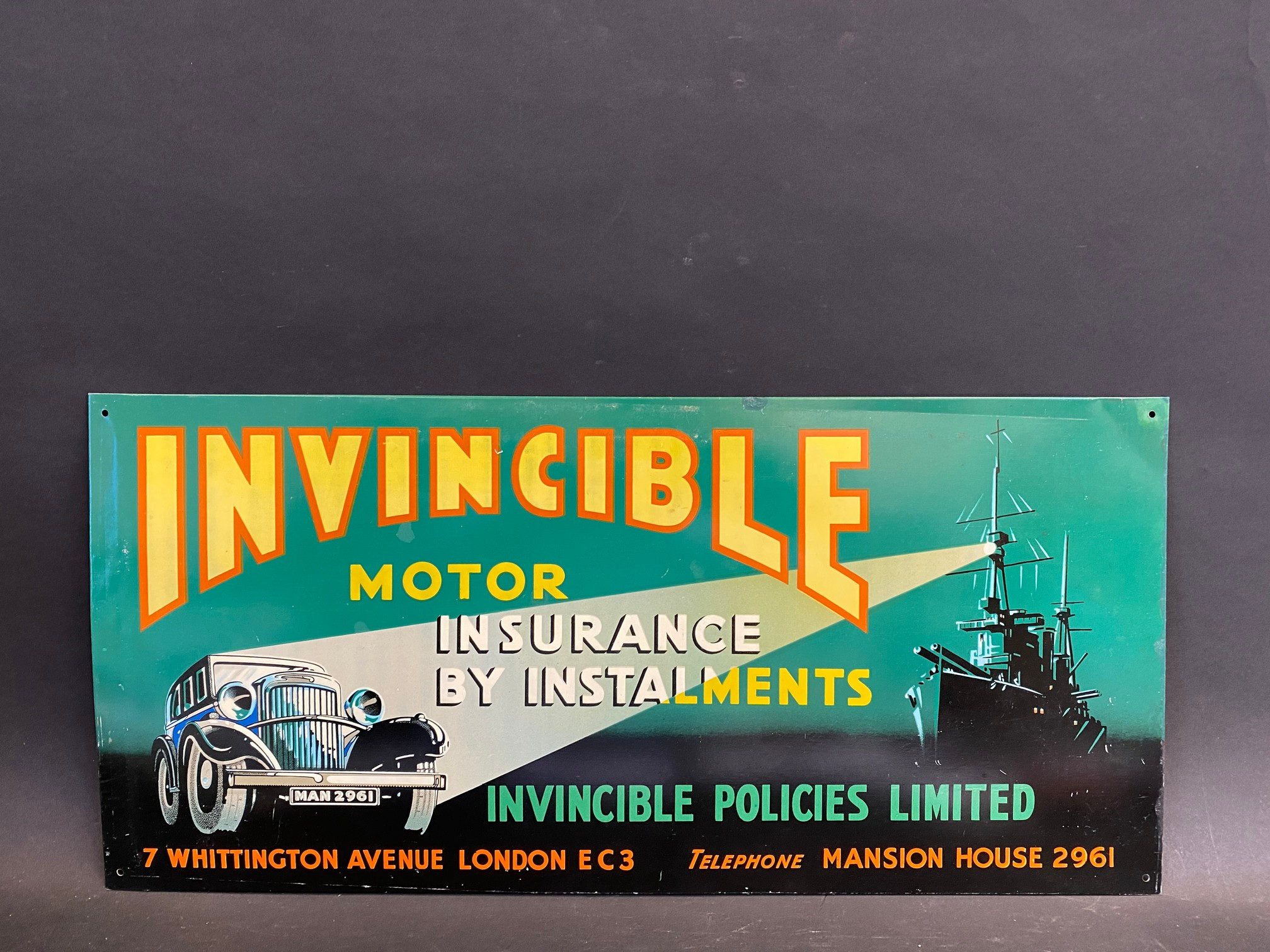 """An Invincible Motor Insurance pictorial tin advertising sign, in very good condition, 20 x 9 1/2""""."""