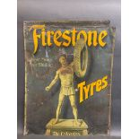 An early and rare Firestone Tyres pictorial tin advertising sign depicting 'The Colossus', trimmed