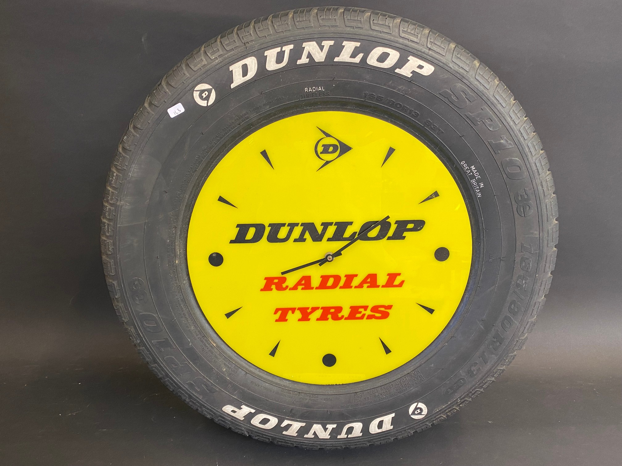"""A quirky Dunlop Radial Tyres perspex advertising clock set within a full size car tyre, 22 1/2"""""""