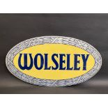 """A Wolseley oval double sided aluminium garage showroom hanging sign, 25 1/2 x 13 1/2""""."""