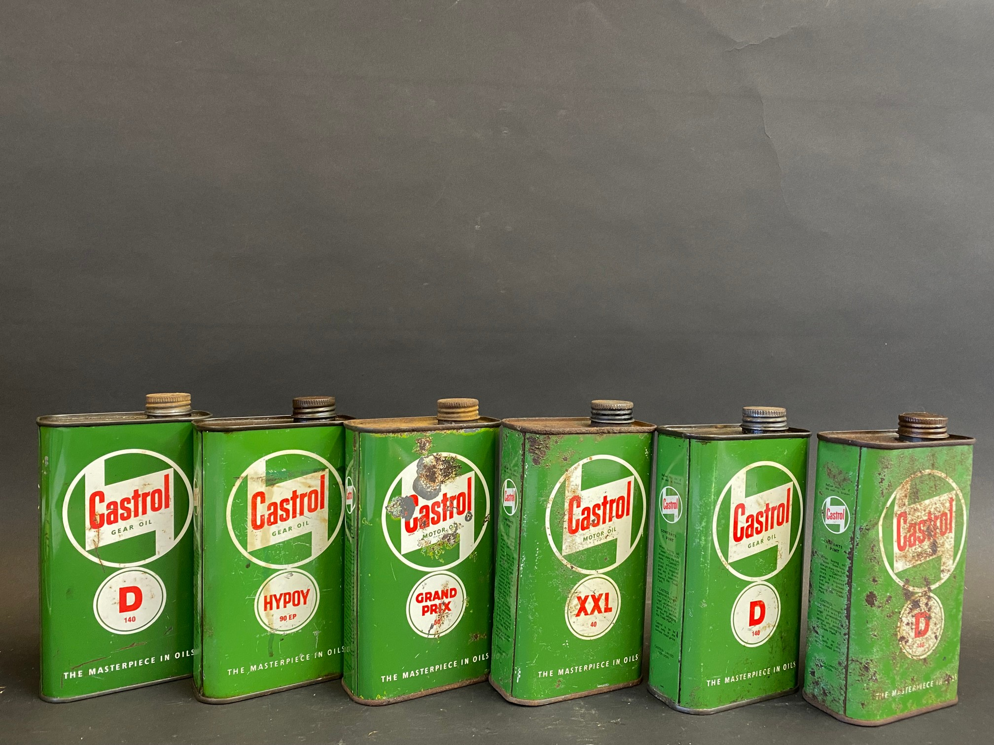 Six Castrol Gear and Motor Oil pint cans.