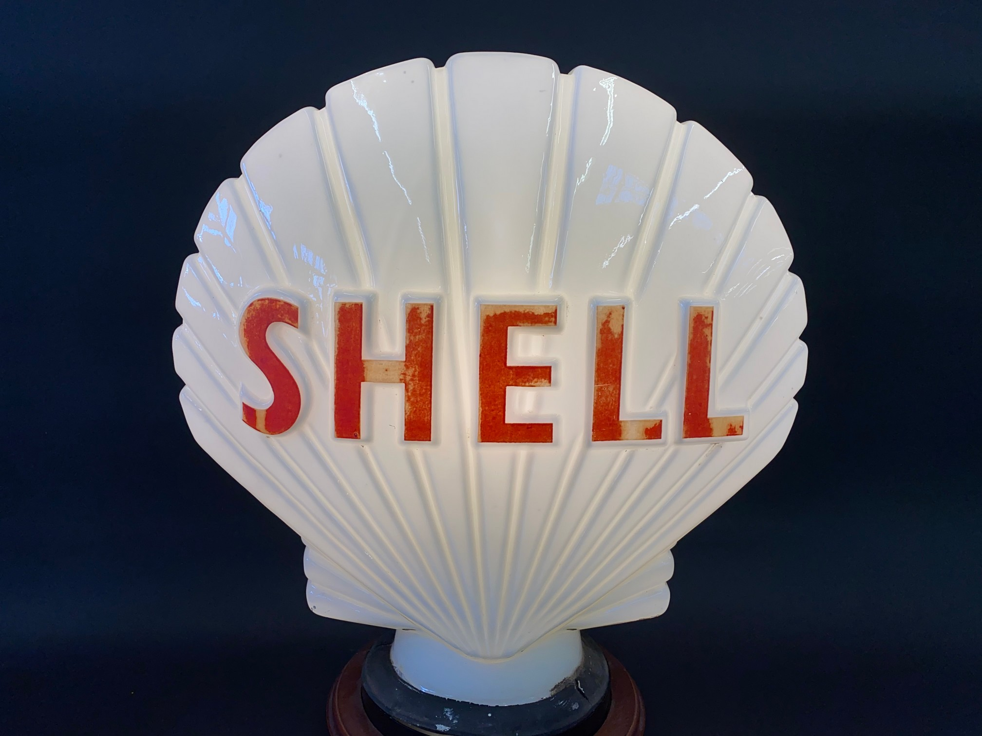 A Shell glass petrol pump globe by Hailware, fully stamped underneath, some damage to the neck under