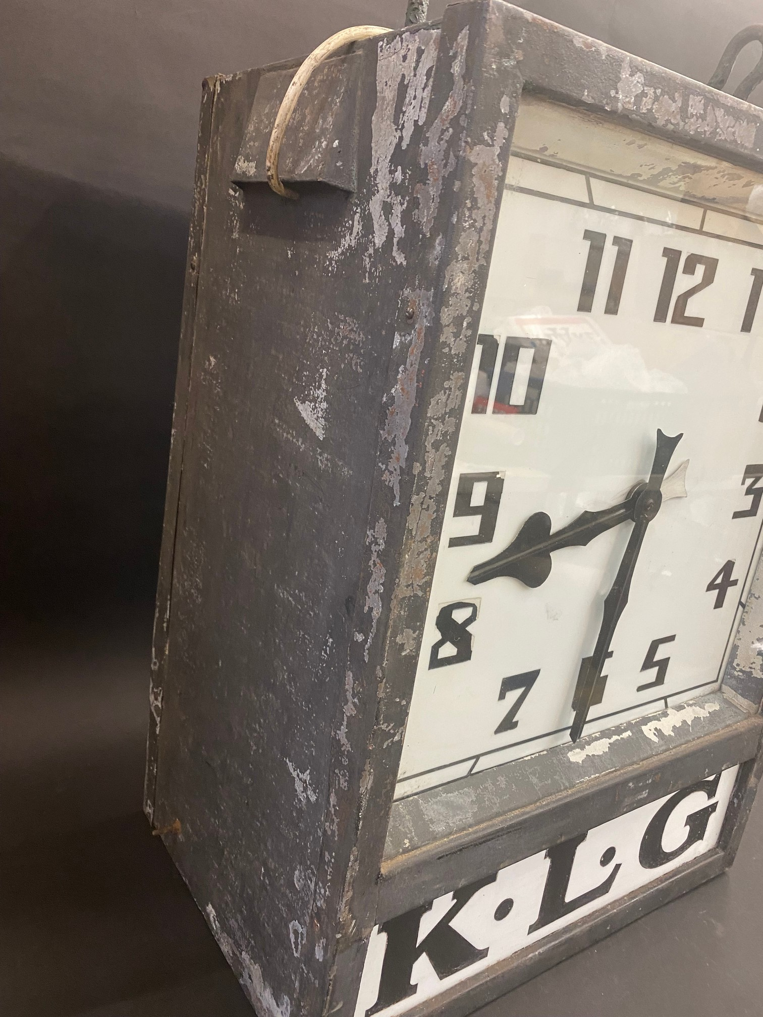 A K.L.G. garage forecourt double sided hanging clock of unusual and attractive form, in very - Image 5 of 12