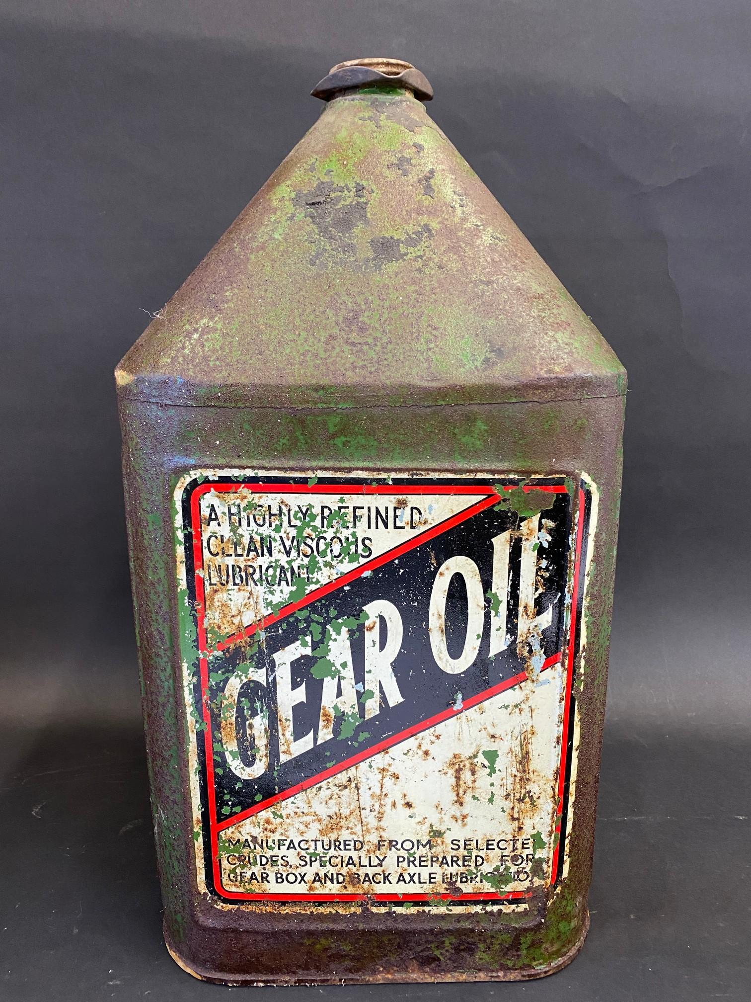 A 'Gear Oil' five gallon square pyramid can.