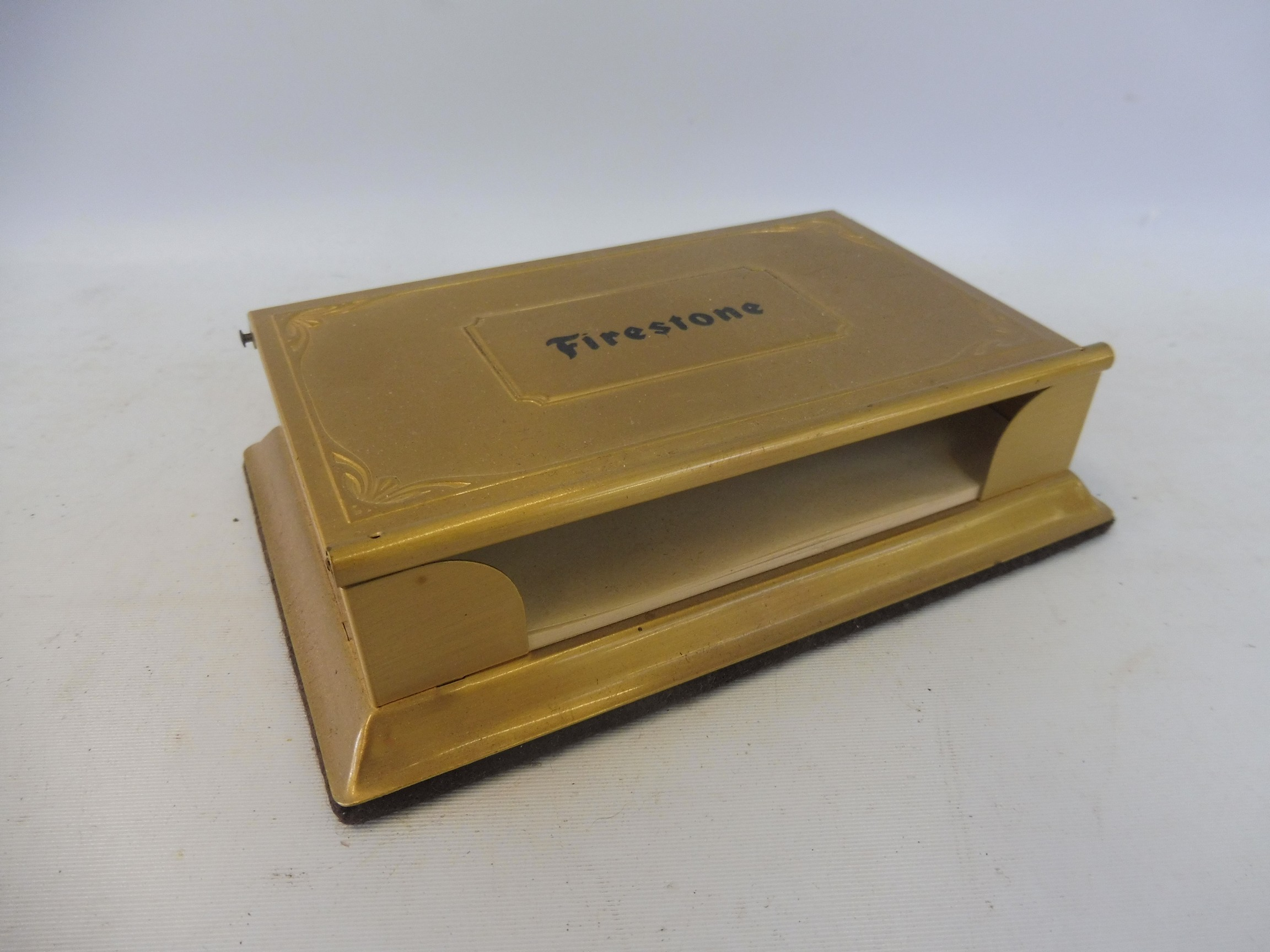 A Firestone tyres advertising brass paper note holder and calendar.