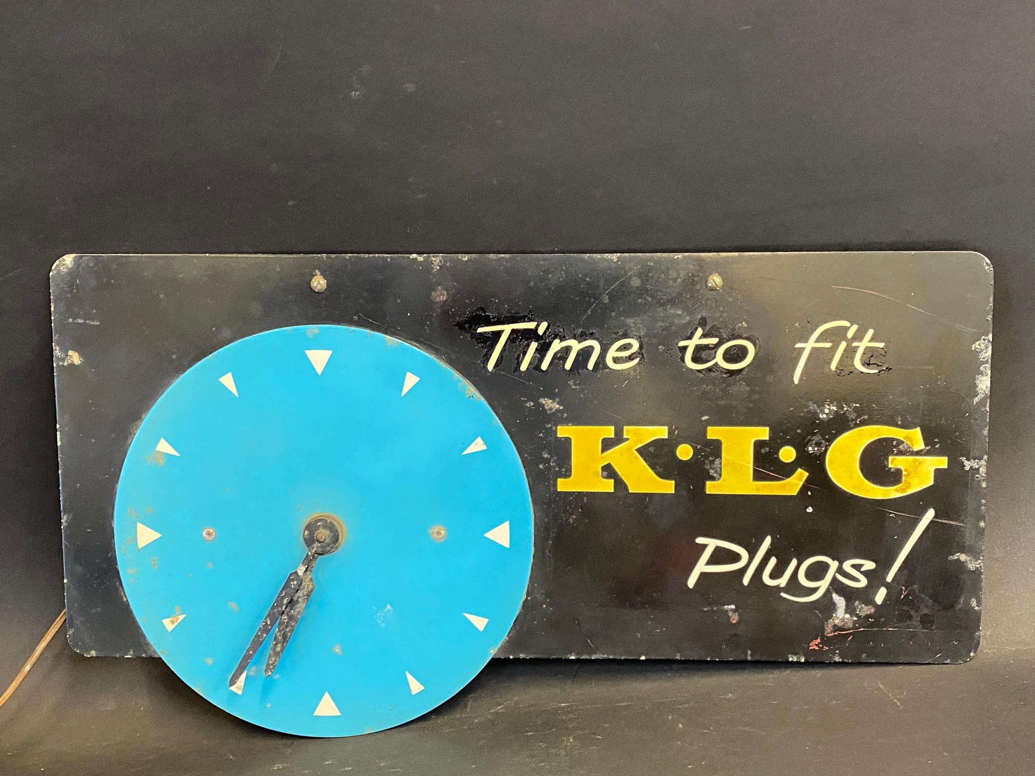 "A K.L.G. Plugs advertising wall clock, 18 x 9 1/2""."