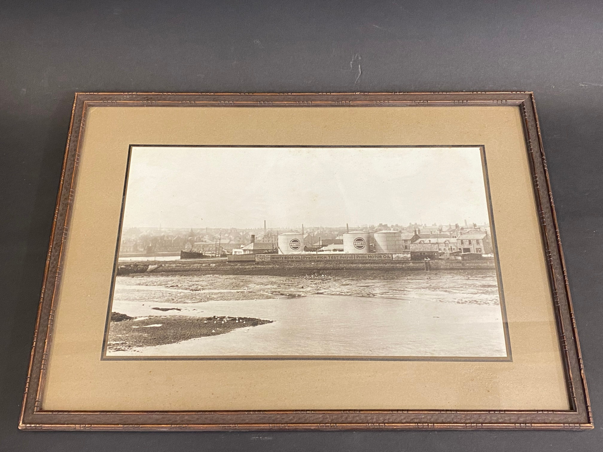 A framed original photograph of the Pratts Refinery at Berwick-upon-Tweed, probably a photograph