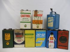 Eight 1 gallon cans including Shell Anti-Freeze, Castrol XL etc plus an Essolube can.