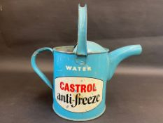 A Castrol anti-freeze watering can.