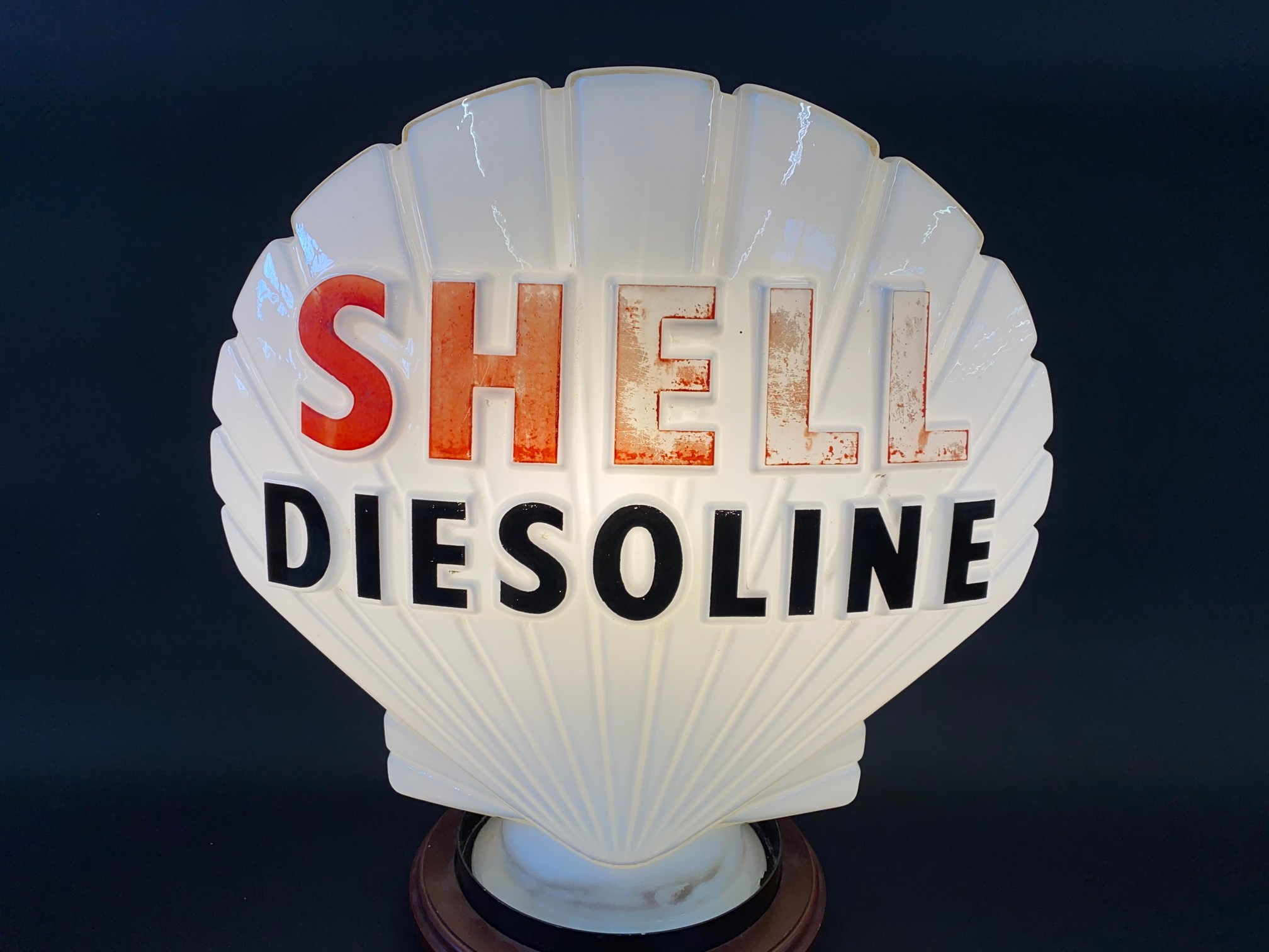 A Shell Diesoline glass petrol pump globe by Hailware, faint stamps underneath, minor nibbles to