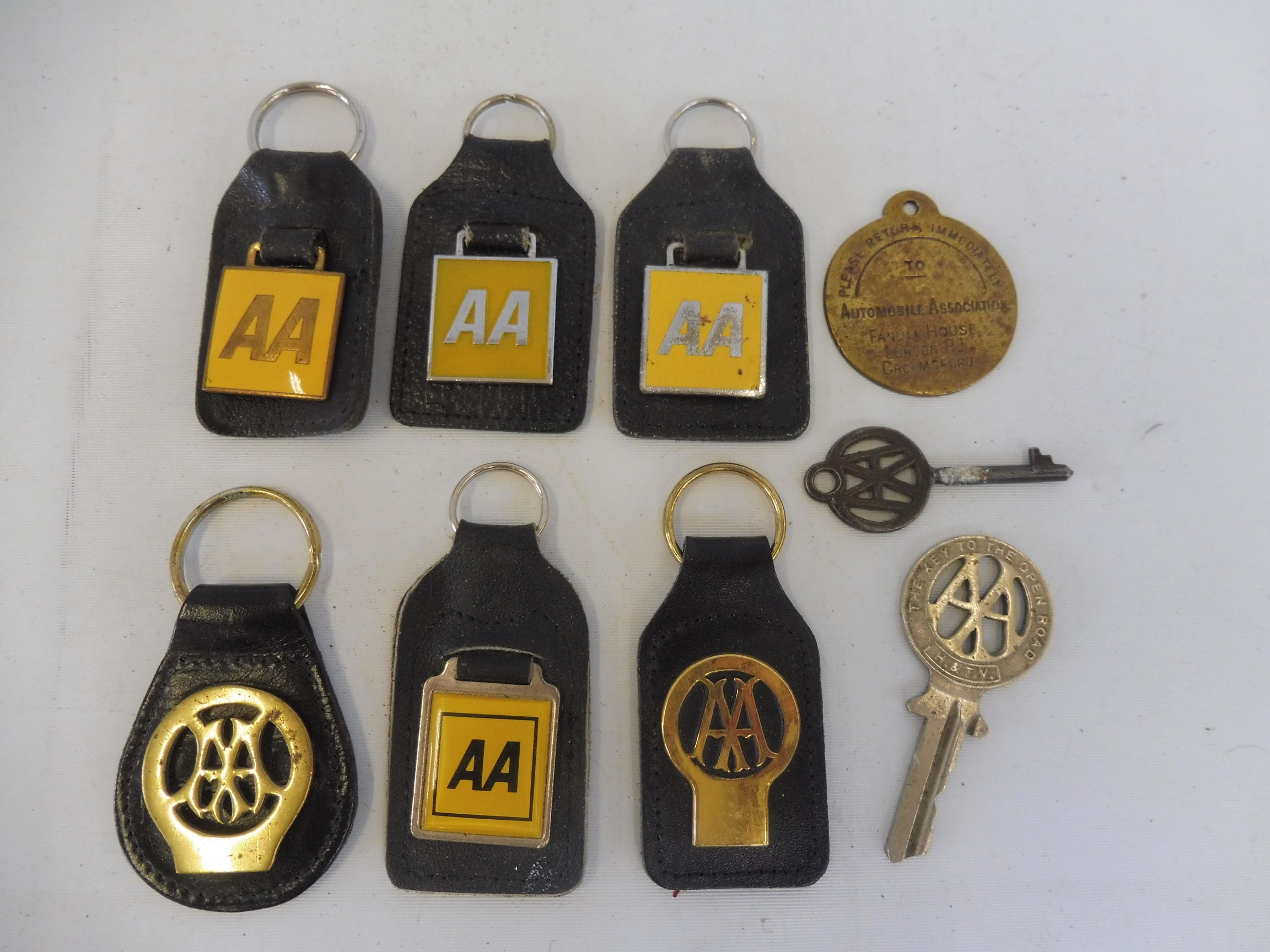 Six different AA keyrings, showing the evolution of the AA emblem, plus two early AA keys and a