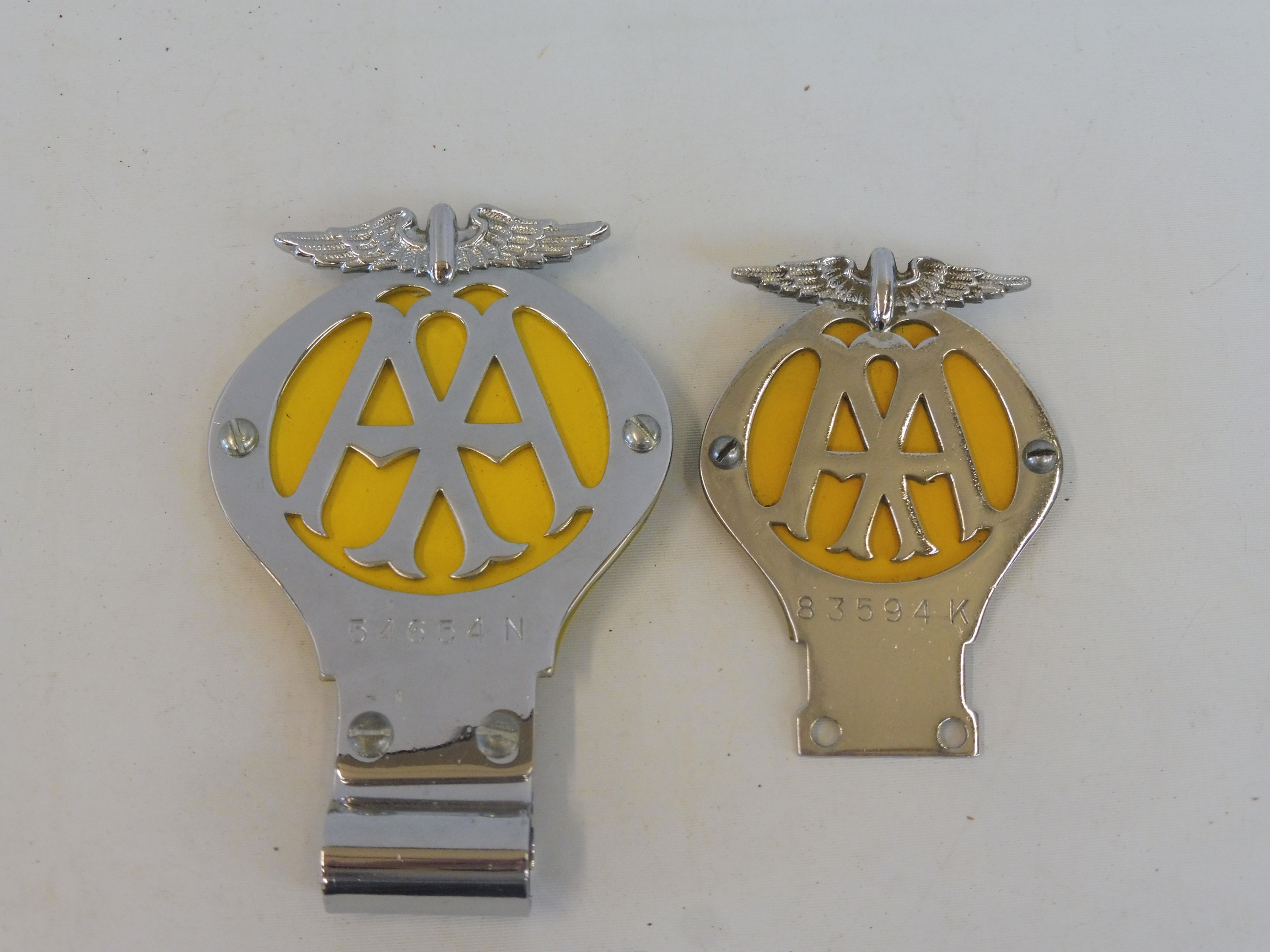 A yellow back AA car badge, side hole version, circa 1939, stamped 54654N with badge bar mounting