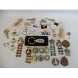 A collection of assorted RAC enamel and plastic badges including two Rally of Great Britain enamel
