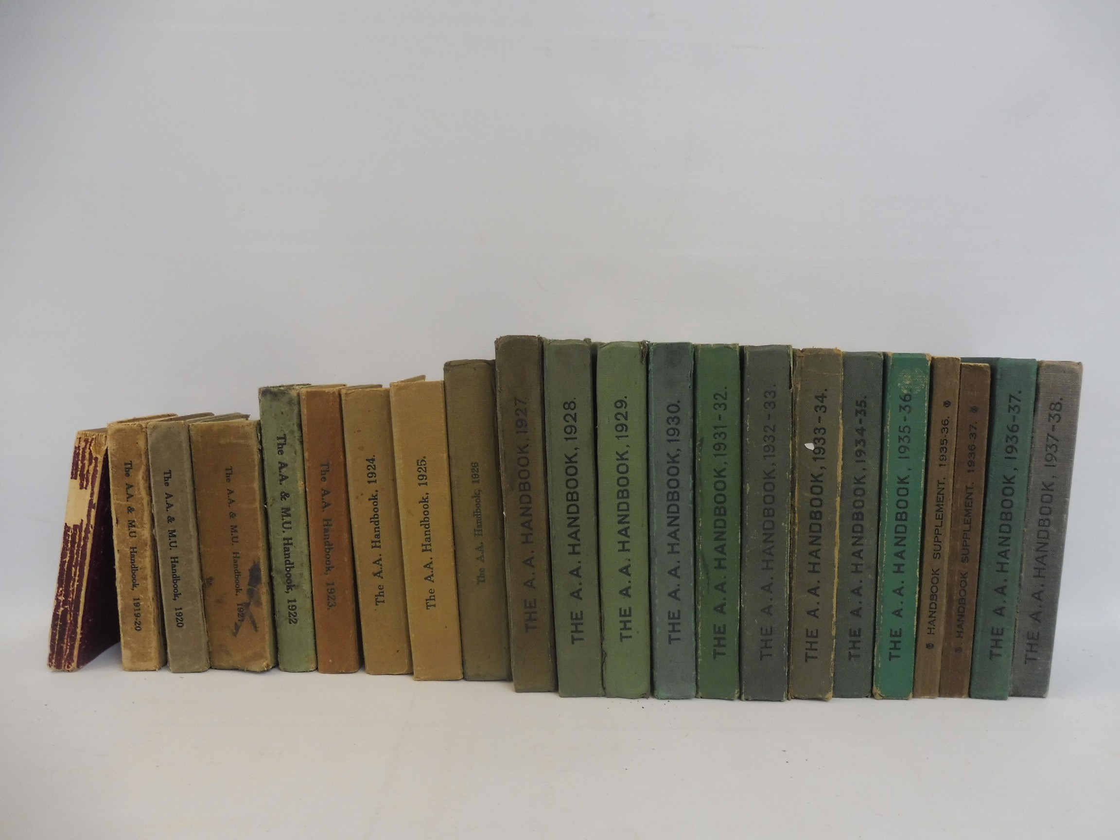The AA and Motor Union Handbook, issues 1913, 1919-1920, 1920, 1921, and 1922, plus The AA