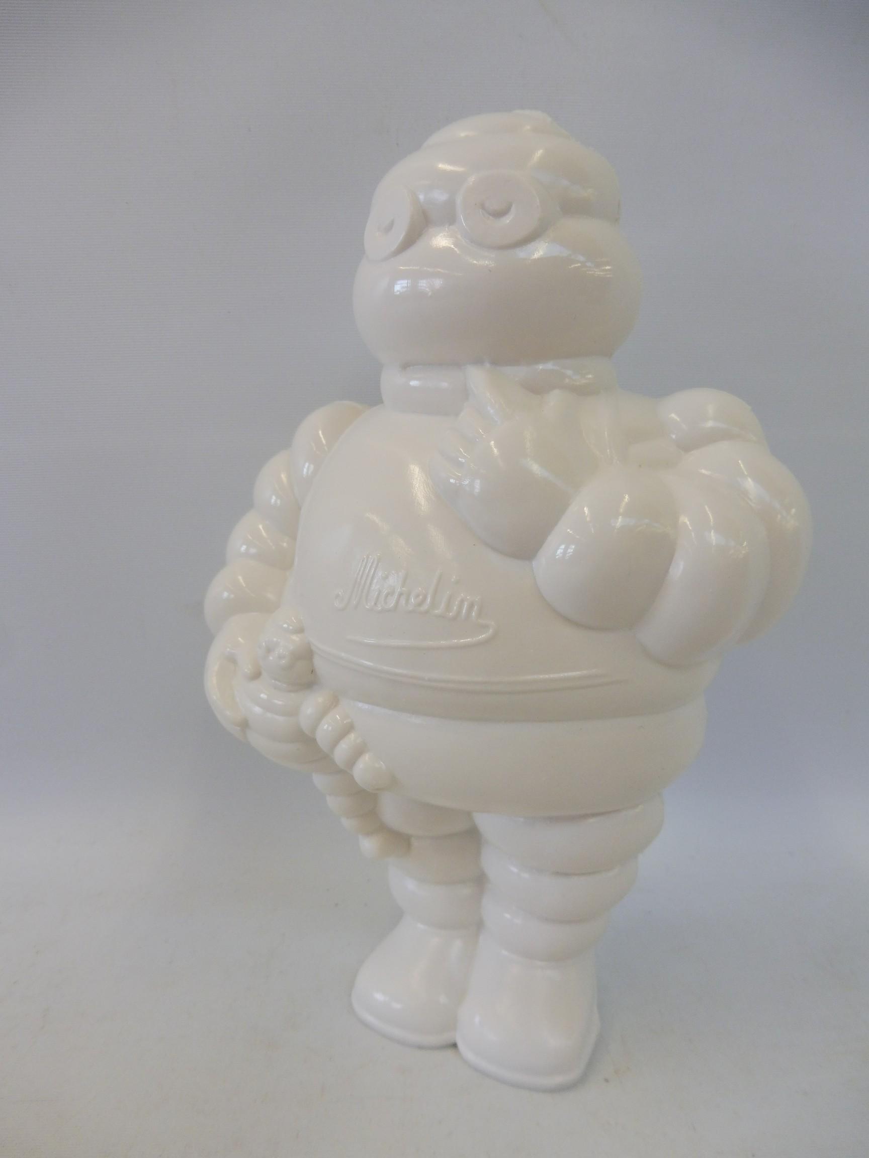 A Michelin plastic figure with a squeak noise maker inside.