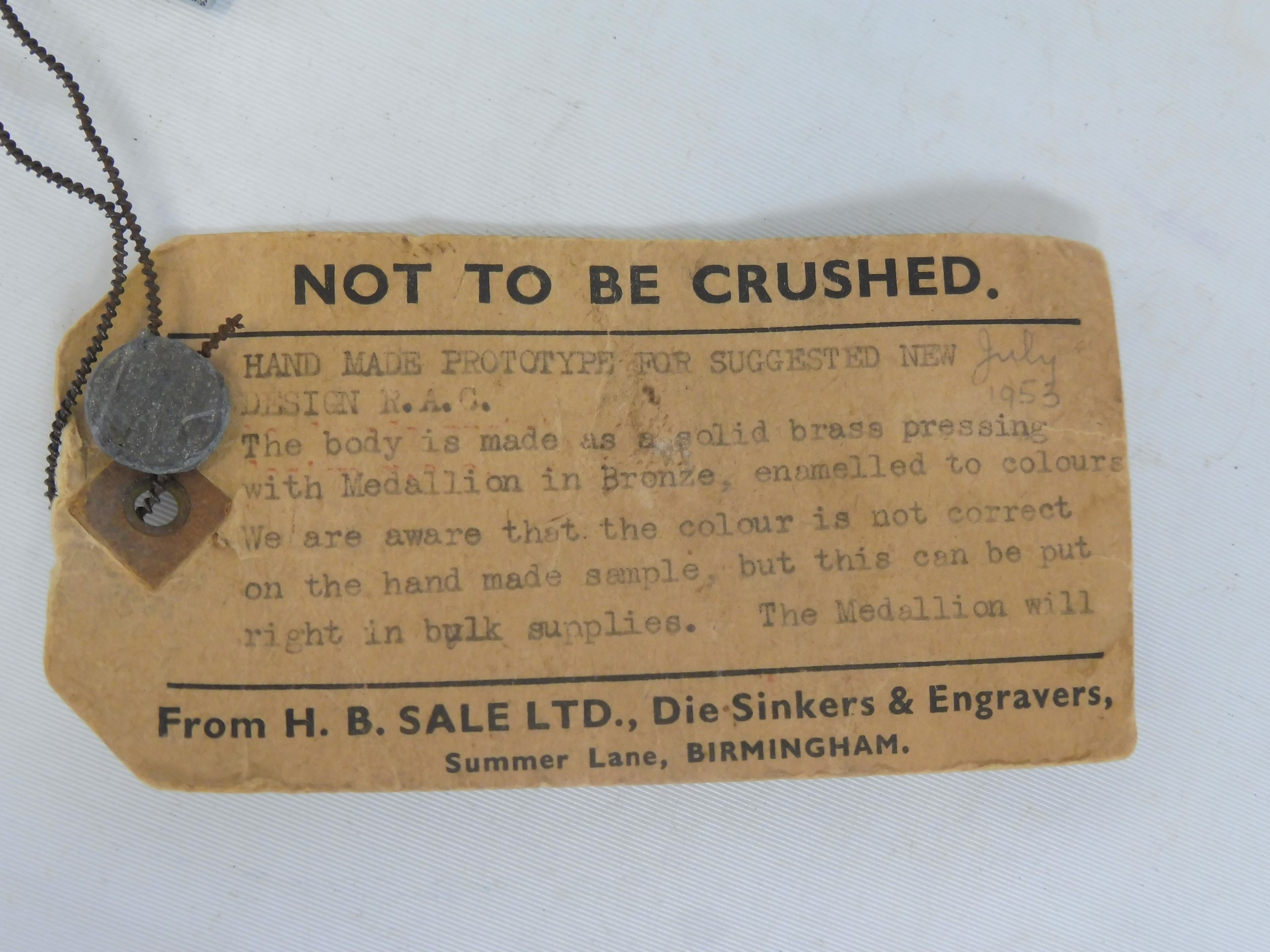 An RAC 1953 prototype car badge, with large lozenge enamel centre, still retaining a cardboard tag - Image 3 of 5