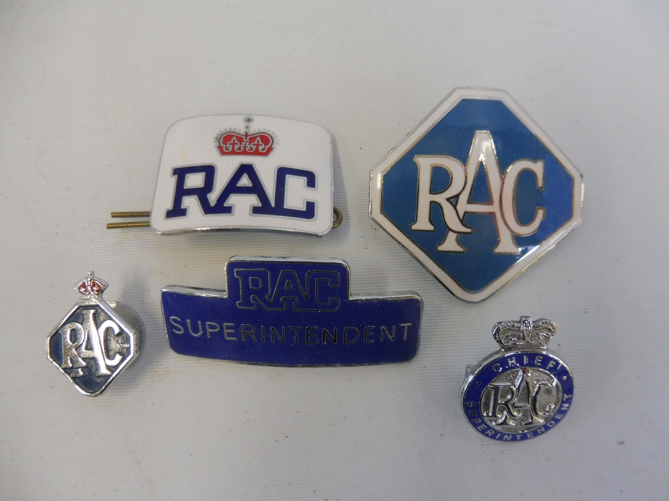 A selection of R.A.C enamel badges including RAC Superintendent and Chief Superintendent.