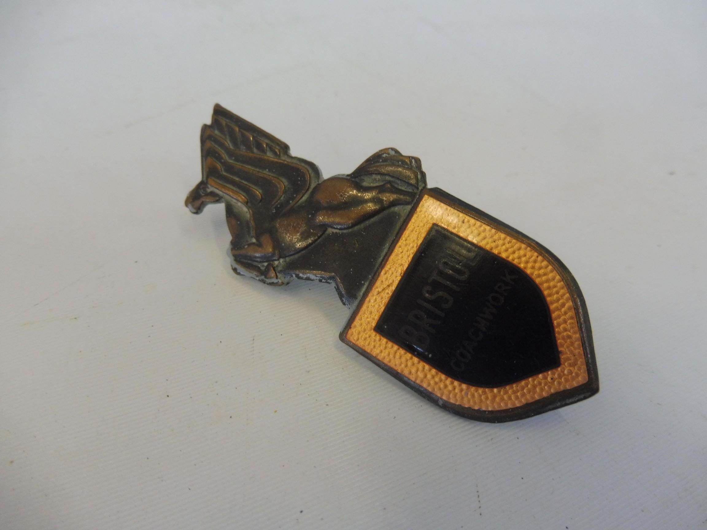 A Bristol coachbuilder's enamel side trim badge.