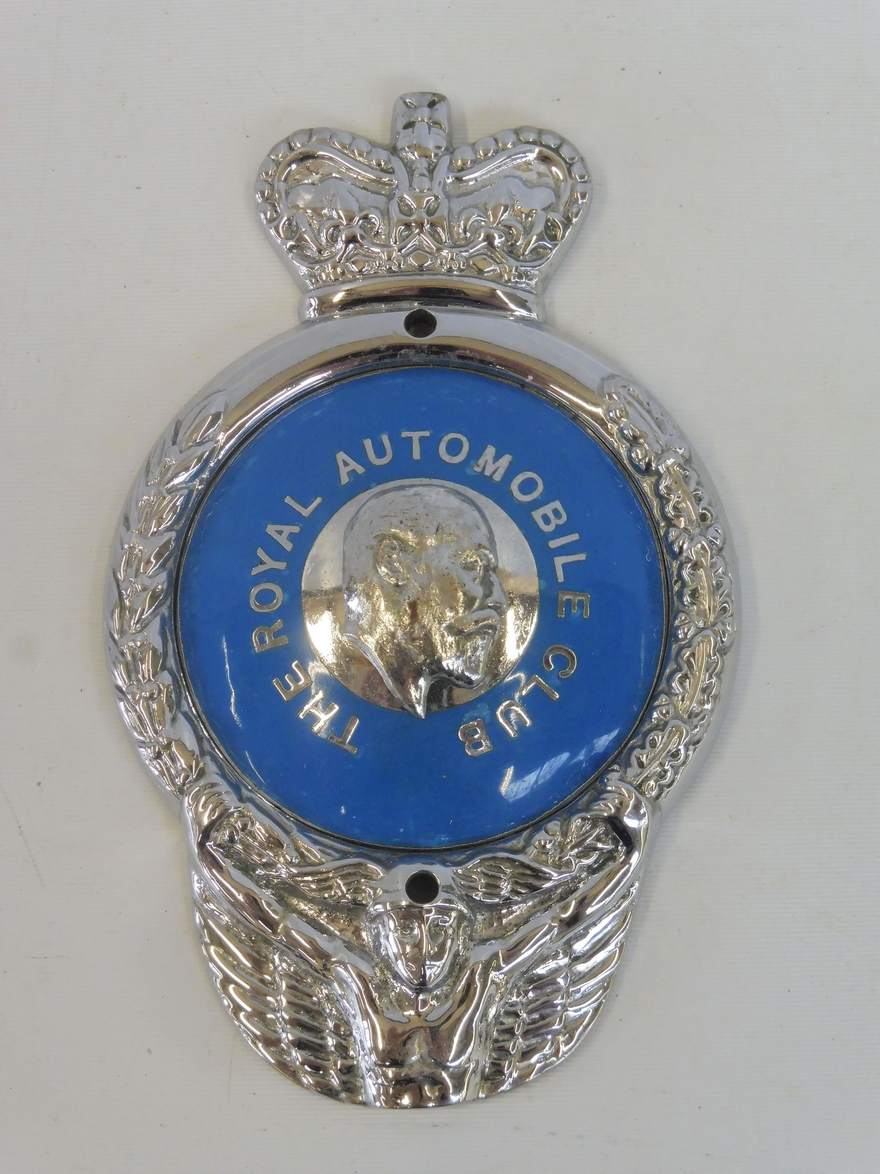 A rare Royal Automobile Club 1953 prototype badge, as featured on the prominant image on page 87
