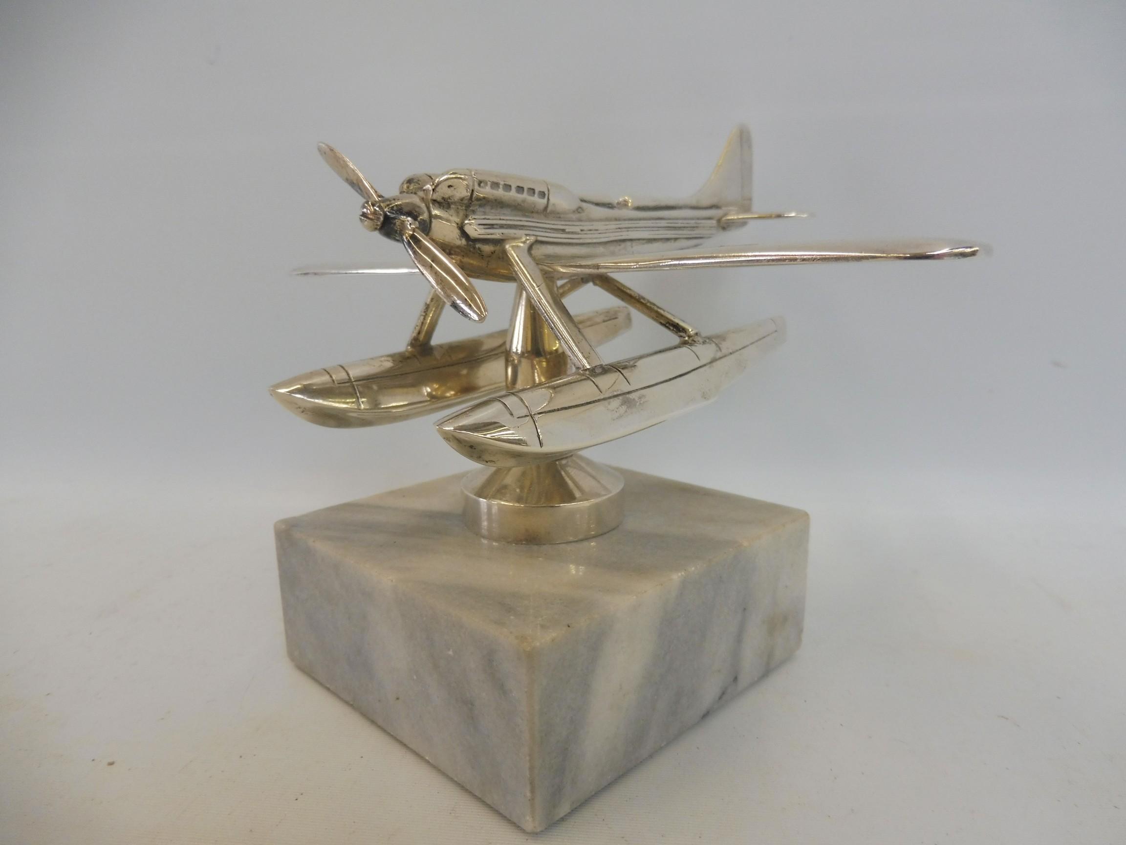 A Schneider Trophy seaplane supermarine mascot, nickel plated, inscribed 'Rolls-Royce' under one