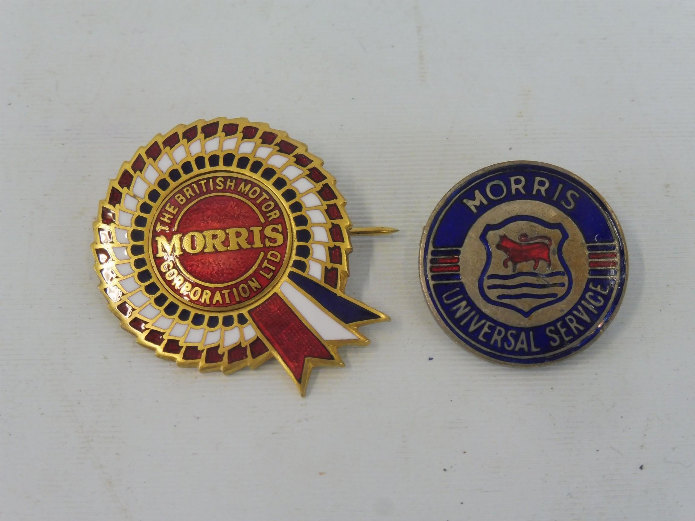 A Morris BMC enamel rosette lapel badge plus a Morris Universal Service badge.