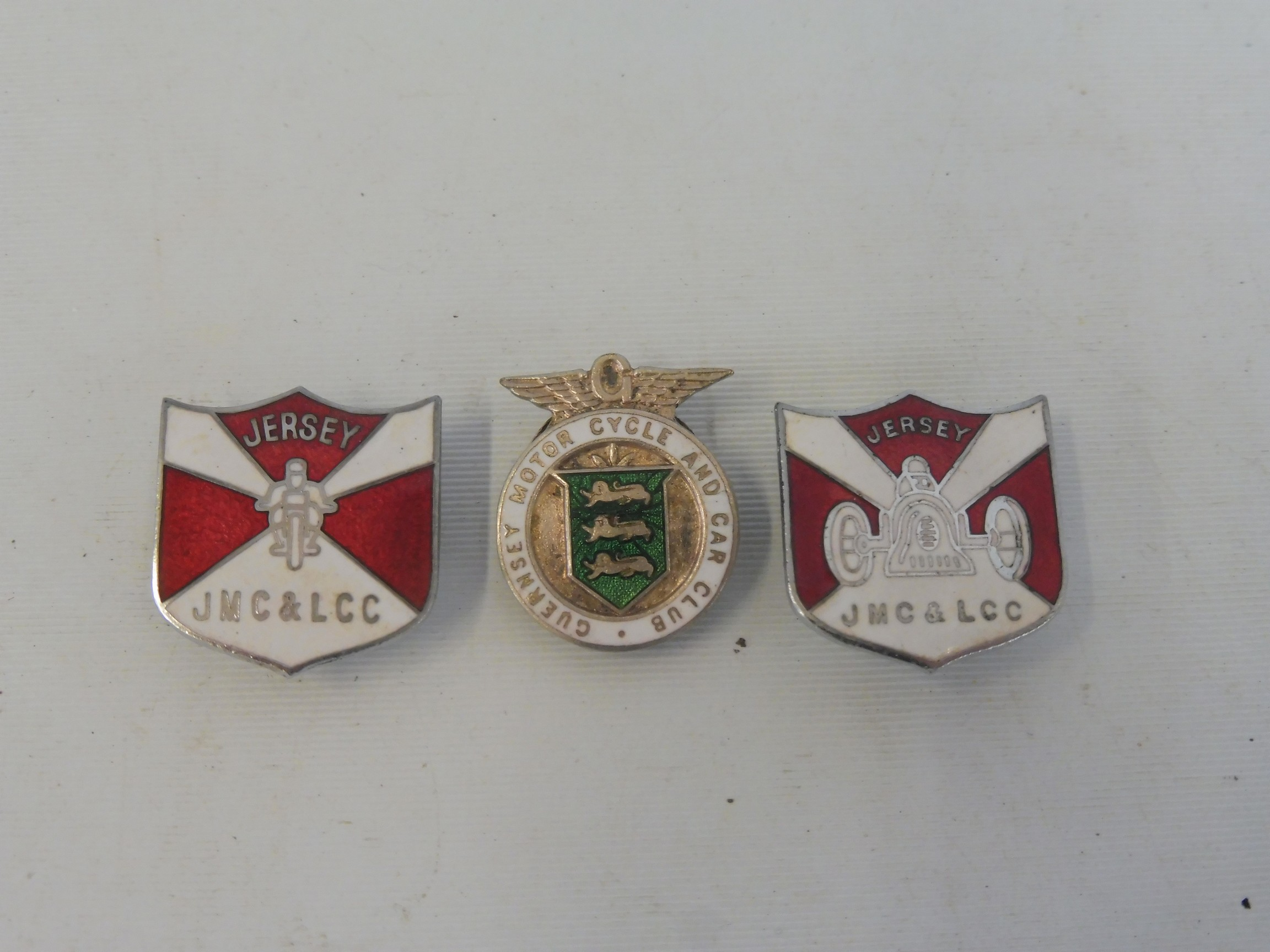 Two Jersey Motor Club and Light Car Club enamel lapel badges plus a Guernsey Motor Cycle and Car