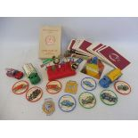A selection of mixed motoring related items including pin badges for Esso, BMW, VW etc, BP &