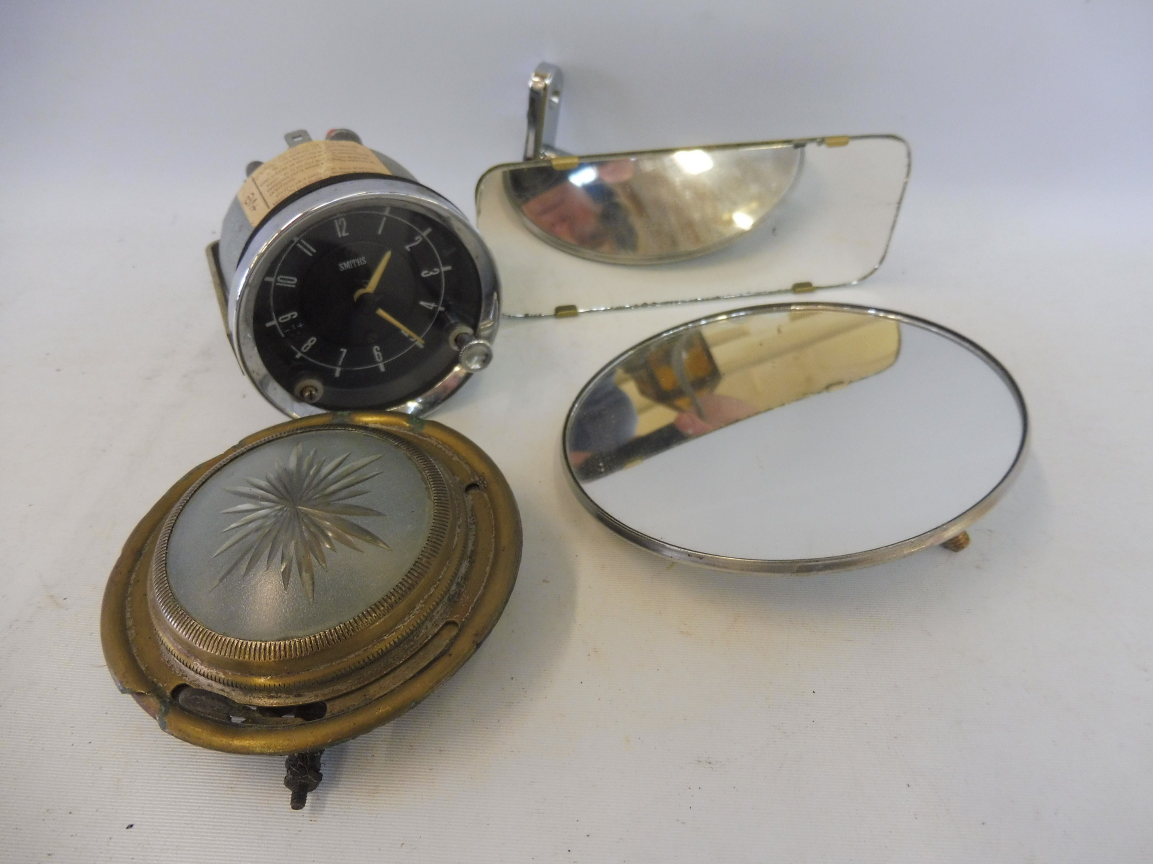 An autojumblers lot of items to include a Smiths car clock, a limousine interior light etc.