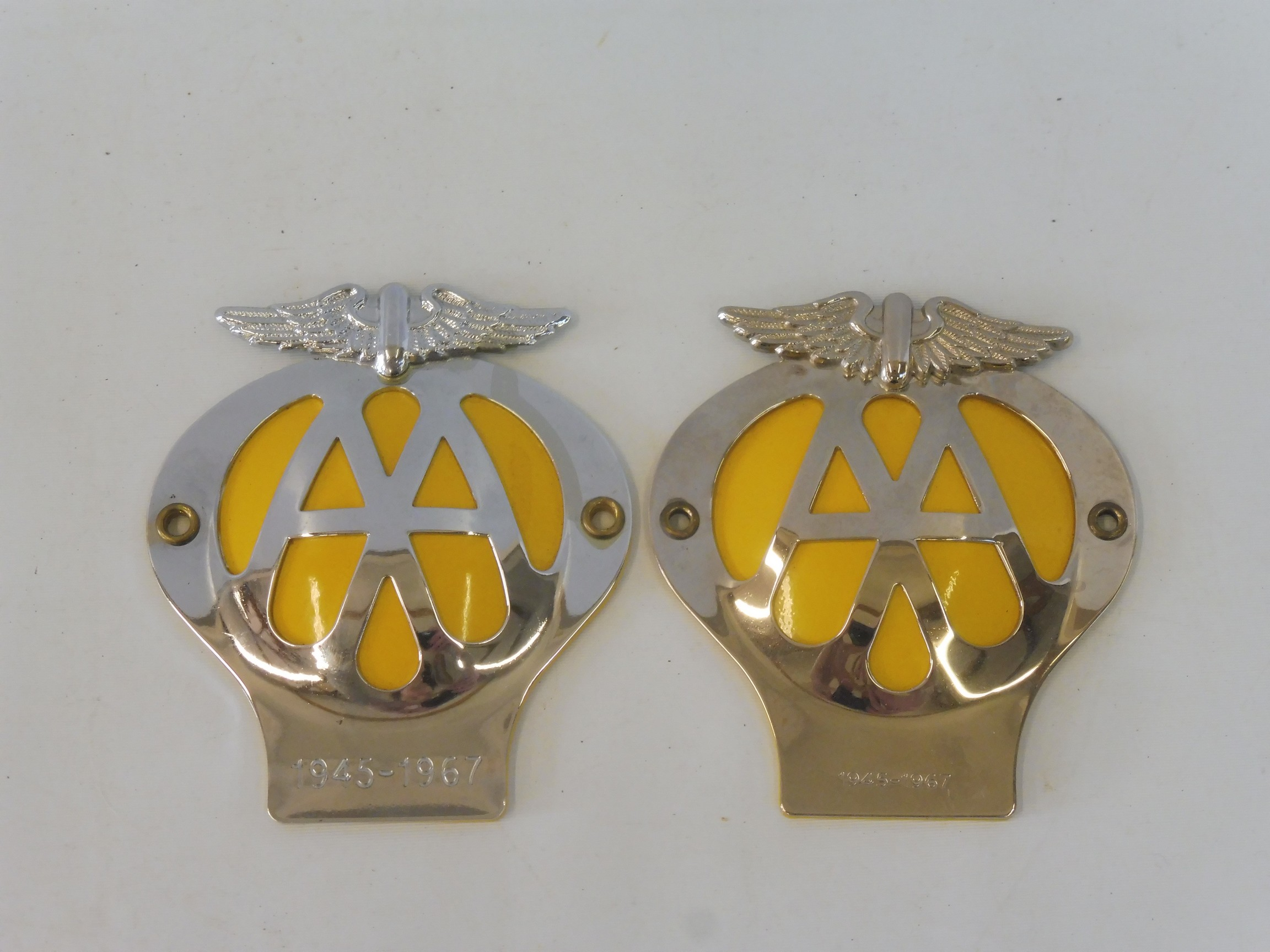 Two AA 1995 Anniversary reproduction badges, type 2A and type 2B both marked with the years 1945-