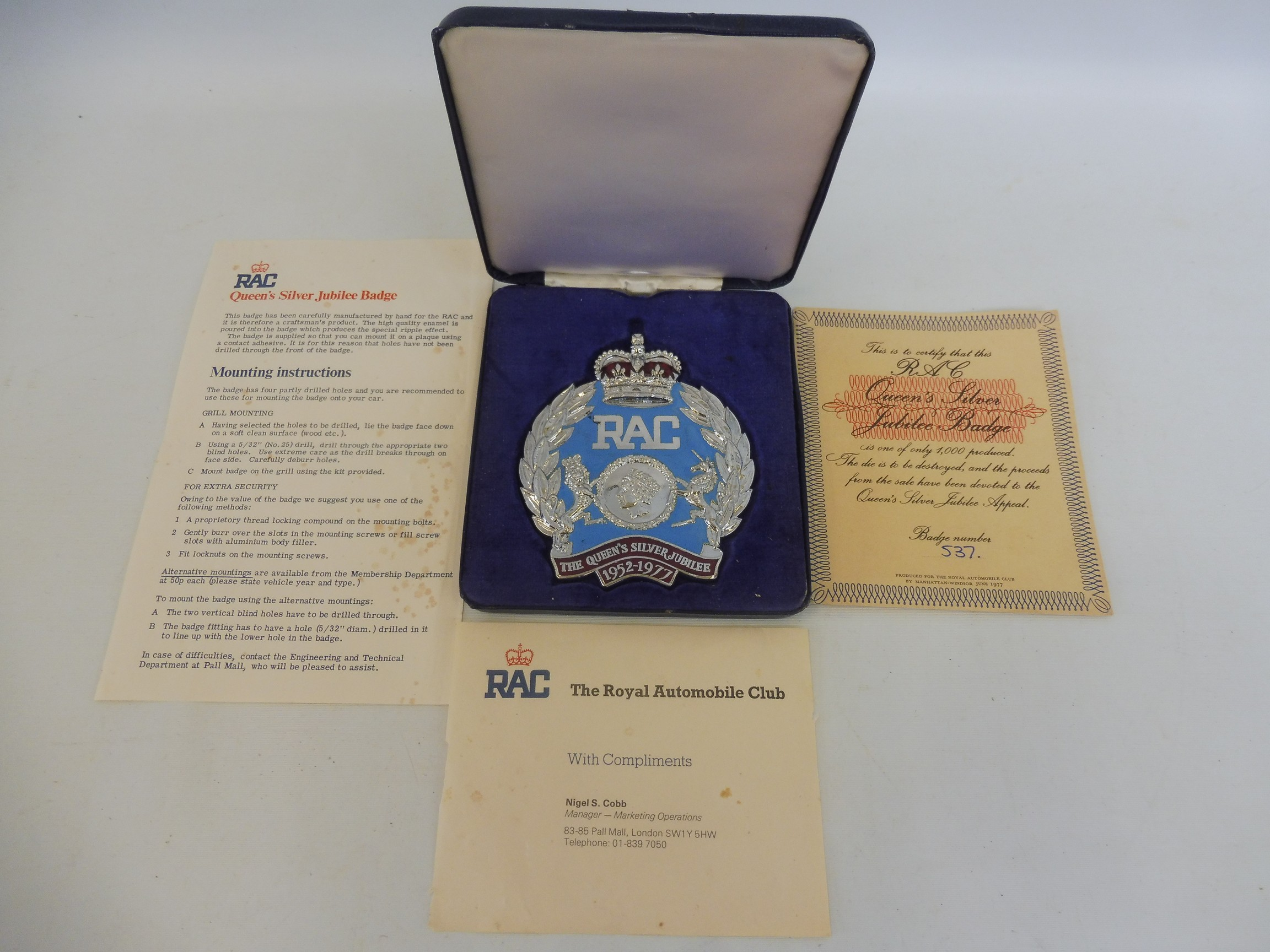 A cased RAC Queen's Silver Jubilee badge, only produced in 1977, no. 537/1,000, with certificate,