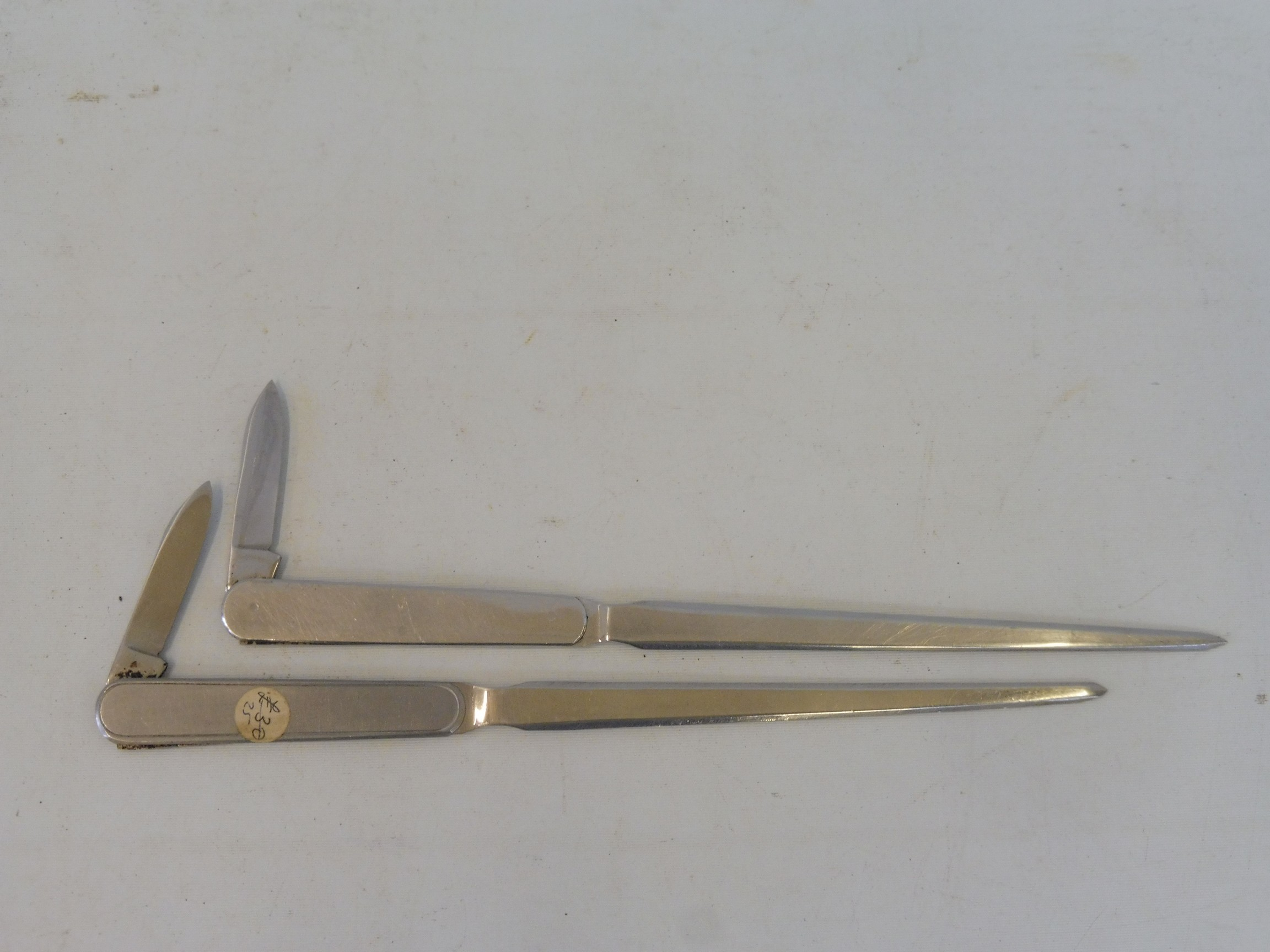 Two letter openers, one advertising Dunlop, the other Triumph (British Leyland). - Image 2 of 2