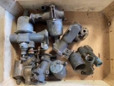 A tray of mostly vintage bronze bodied carburettors.