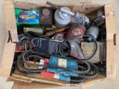 A box of tools and car parts.