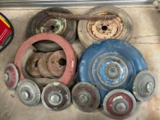 A collection of Alvis 14hp parts to include six hubcaps, two wheels, spare wheel covers, brake drums