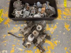 A collection of assorted carburettors, some believed to be Ford, VW, Morris etc.